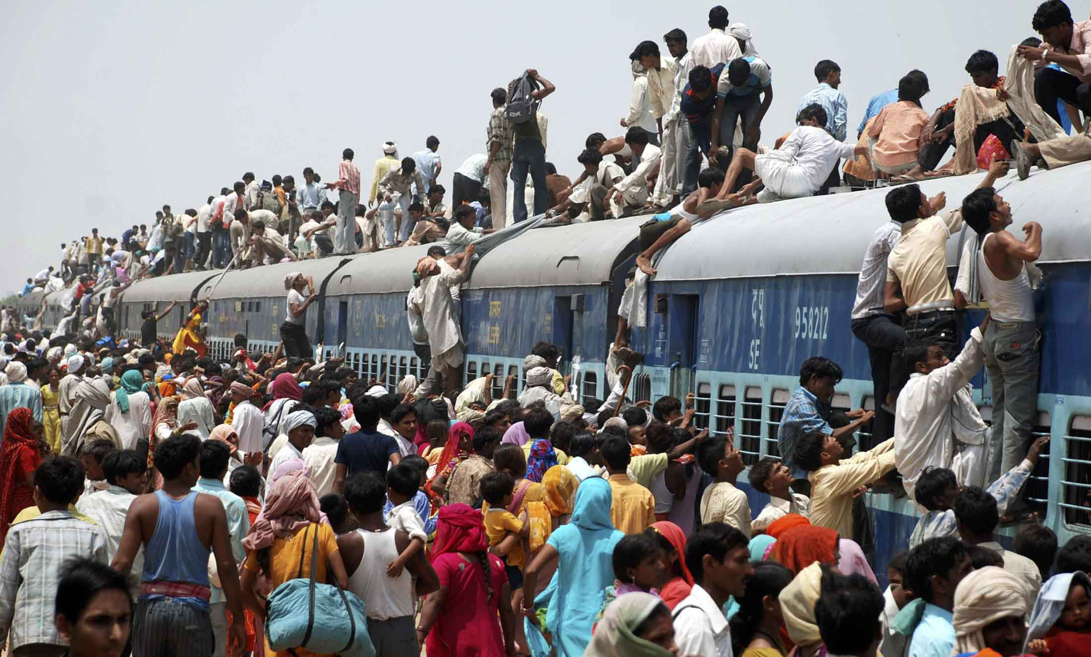 world population day our strength or weakness fiinovation  hindu devotees try to board a crowded passenger train to take part in the guru